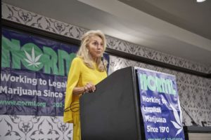 Eleanora Kennedy, widow of Michael Kennedy, speaks at the 2019 NORML Conference